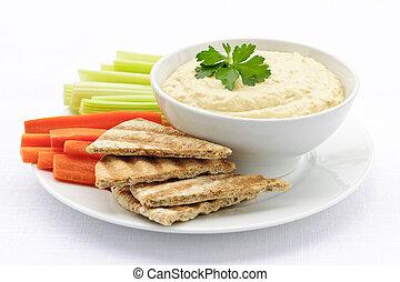 Hummus con pan de pita y verduras