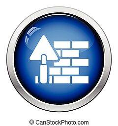 Icono de pared de ladrillo con pala