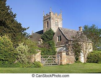 Iglesia y cabaña Cotswold