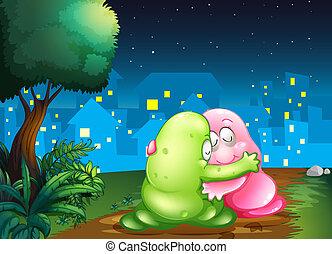 Ilustración de una pareja de monstruos rosados y verdes abrazados en el camino