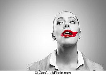 Imagen conceptual con boca roja viva