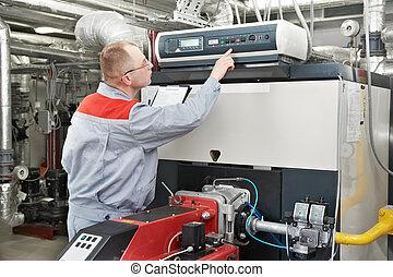 Ingeniero calentador en sala de calderas