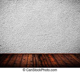 Interior de habitación con pared blanca