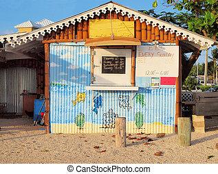 Islas Caimán, restaurante frente a la playa