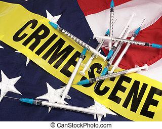 Jeringas y escenas de crimen acordonan la bandera americana