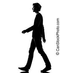 Joven silueta triste caminando