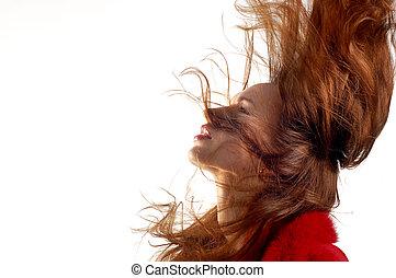 Jovencita con pelo en movimiento