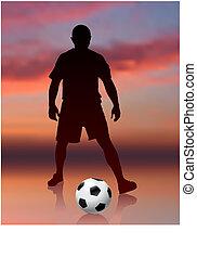 Jugador de fútbol en el fondo de la noche