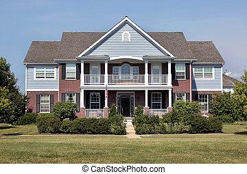 La casa de los ladrillos con el asiento azul