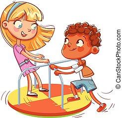 La chica y el chico van en carrusel pequeño. Parque de diversiones