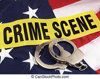 La escena del crimen y las esposas de mano sobre la bandera americana