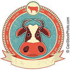 La etiqueta de la cabeza de vaca en la textura de papel antiguo. Estilo de vintage