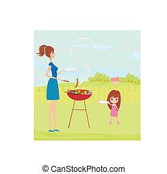La familia está de picnic en un parque