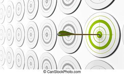 La flecha verde golpea el centro de un blanco verde. Hay blancos grises alrededor