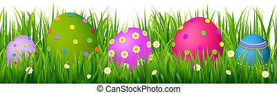 La frontera con hierba y huevos de Pascua