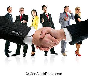 La gente de negocios saluda y equipo de empresa