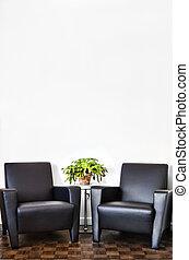 La habitación interior moderna y la pared blanca