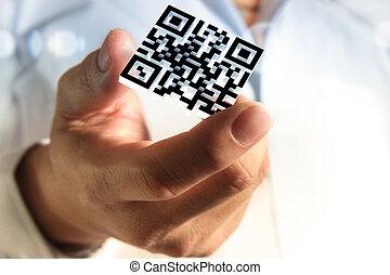 La mano de negocios muestra 3d código Qr