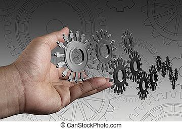 La mano muestra a la gente los engranajes como concepto