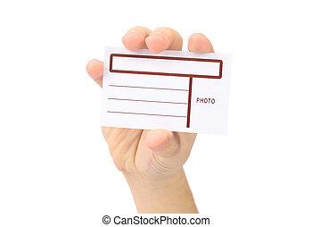 La mano muestra la tarjeta