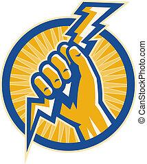 La mano sostiene un relámpago de electricidad dentro de un círculo.