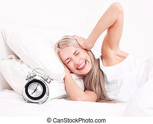 La mujer se despierta