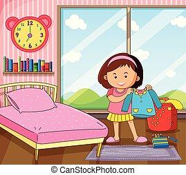La niña se viste en el dormitorio