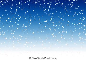 La nieve cae sobre el cielo azul del invierno