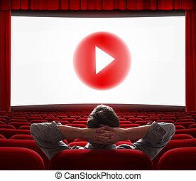La pantalla de cine en línea con el botón de los medios en el centro