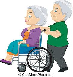 La pareja mayor con la anciana en la silla de ruedas