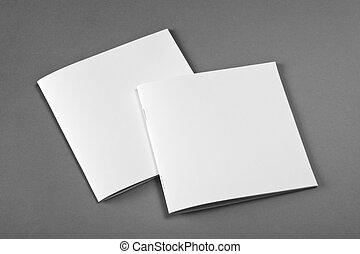 La revista Blank Brochure aislada en gris para reemplazar tu diseño.