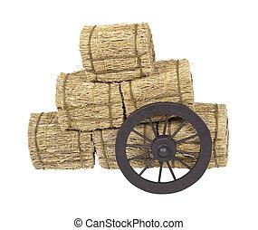 La rueda de la diligencia apoyada en fardos de heno