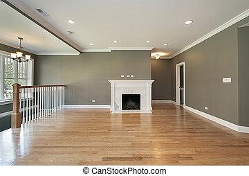 La sala de estar con la baranda blanca