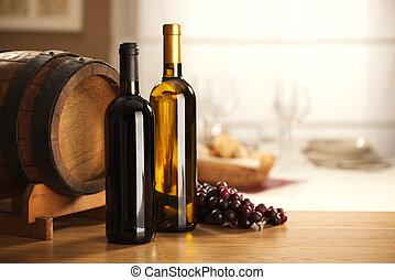 La selección de vinos con barriles y uvas