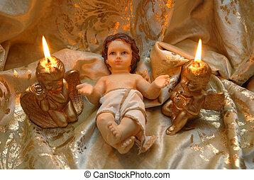 La tarjeta de Navidad, el bebé Jesús y dos velas encendidas