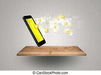 La tecnología móvil de la comunicación moderna muestra a la red social en el estante de madera