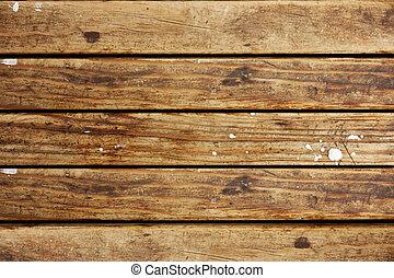 La textura de madera marrón con gotas blancas de pintura