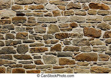 La textura natural de la pared de piedra