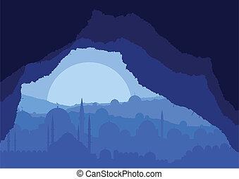 La vista de cuevas mágicas sobre el paisaje de la ciudad islámica