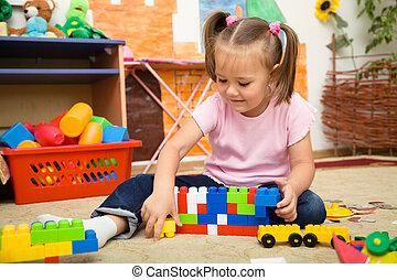 ladrillos de edificio, niña, juego