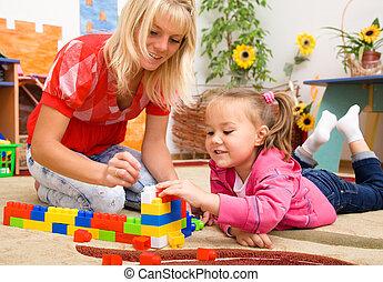 ladrillos, juego, profesor, niño