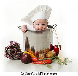 Lamiendo al bebé sentado en la olla de un chef