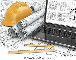 Laptop y el plano con proyecto de la casa.