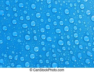 Las gotas de agua sobre fondo azul