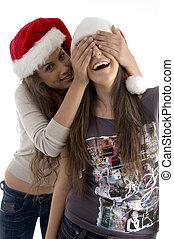 Las hermanas en sombreros de Navidad