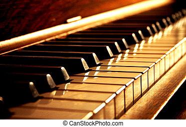 Las llaves del piano dorado