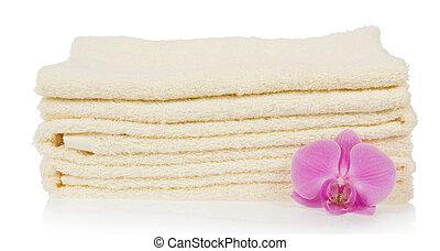 Las toallas de baño decoradas con flores de orquídea