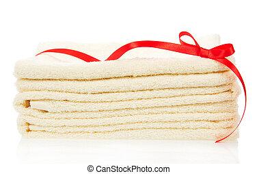 Las toallas de baño decoradas con una cinta