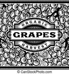 Las uvas retro cosechan etiqueta en blanco y negro