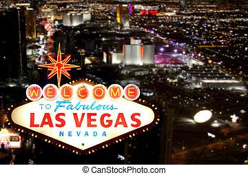 Las Vegas, señal de bienvenida con el turno nocturno en el fondo